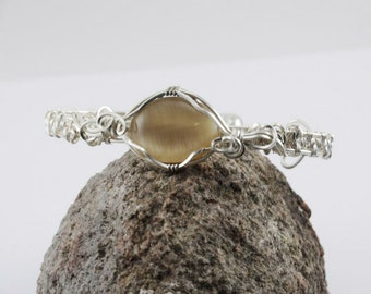 Silver Wire Wrapped bracelet with a cat's eye focal and magnetic clasp