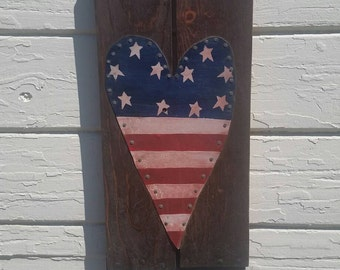 Tin snipped americana wood sign