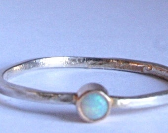 sterling silver opal ring with a 14k gold setting