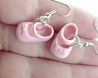 Tiny pink doll shoe earrings