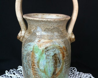 A Decorative Glazed Pottery Vase With Handle