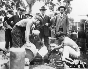 The Orange County (California) Sheriff is shown dumping bootleg booze during Prohibition Photo Print