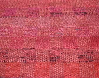 Handwoven small floor rug