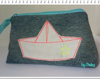 Cosmetics bag paper boat out of jeans