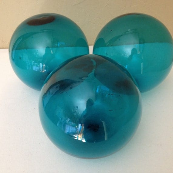 Vintage set of three large blue blown glass orbs balls