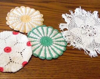 Vintage linens.  3 crochet pot holders, and 1 fringed doily.  1950s,  Some slight staining