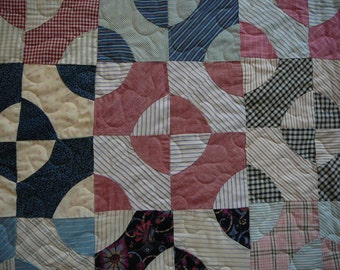 Vintage 1920-1930's hand pieced quilt in queen size with feedsack fabrics