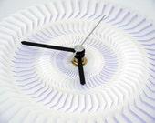 Blade. White on white hand cut paper clock