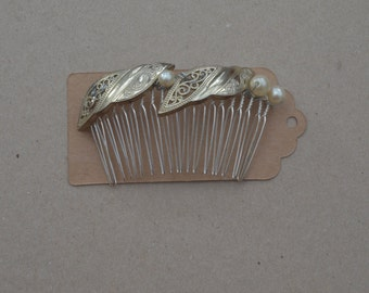 Gold upcycled hair comb.