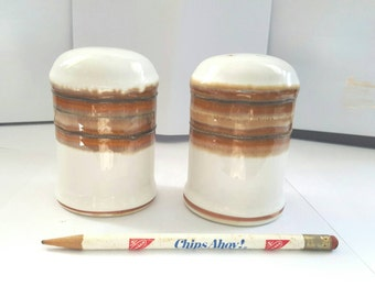 VINTAGE salt and pepper shakers in white ceramic with shades of brown.