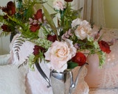 Romantic floral arrangement of roses and fern in a vintage coffee urn.  Think vanity or bedside table.