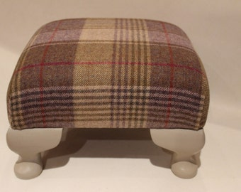 Footstool upholstered in purple/green tweed with painted Queen Anne legs