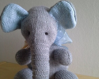 Blue and grey knitted elephant.
