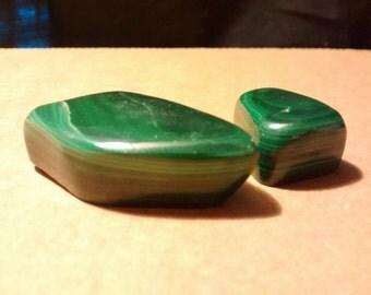 Two self-healed malachite stones