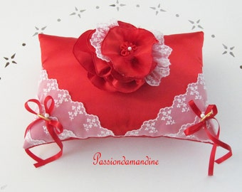 wedding ring cushions red satin with a flower and lace