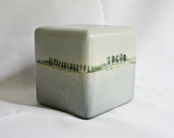 artistic ceramic cube with lit, with a landscape in the glazing.