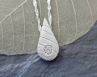 Fine silver textured pendant set with a 3mm high quality Cubic Zirconia
