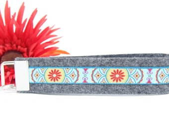 Lanyard made of grey wool felt with colorful ribbon