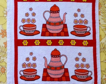 1970s tea towel with retro coffee pot and flower power print