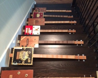 4 String Acoustic/Electric Cigar Box Guitars, in stock or made to order. On sale for graduation!