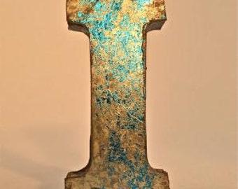 A fantastic vintage style metal 3D blue letter I