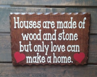 Houses are Made of Wood and Stone but Only Love Can Make a Home Sign