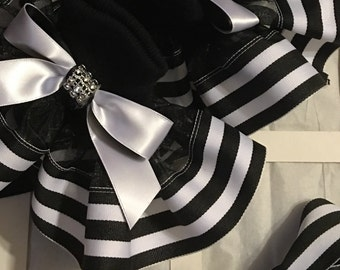 Girls black and stripes socks and bows