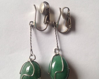 Sinple dangling green stones. Probably jade.