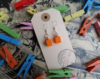 orange lego earrings