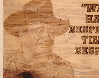 John Wayne quote on rough barnwood.
