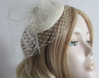 CREAM and IVORY FASCINATOR,  Sinamay Button,with Crin,crystal detail and Fine netting, on a headband