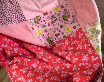Pink patchwork blanket with fleece on reverse