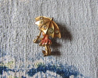 Small vintage cold-painted enamel gold-tone girl with umbrella brooch