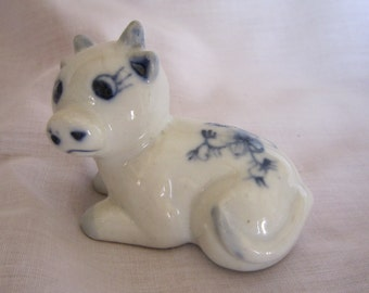 Blue and White Ceramic Cow