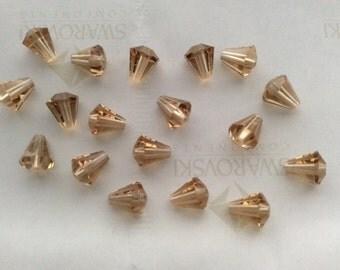 24 pieces Vintage Swarovski #5400 6.6x6mm Crystal Light Colorado Topaz Cone Faceted Beads