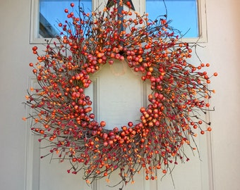Autumn, Fall, mixed orange and red berry and pip berry grapevine sunburst wreath, rustic, primitive
