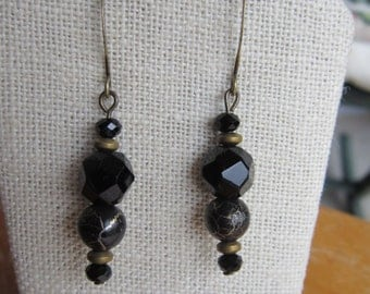 Black and gold drop earrings with vintage glass beads