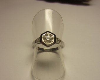 white gold solitaire diamond ring