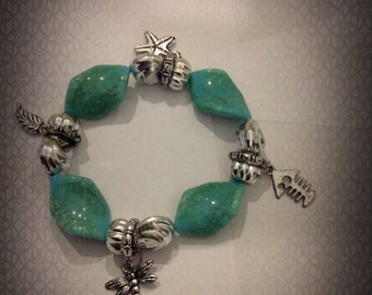 Turquise beads and multi colored silver charm stretch bracelet