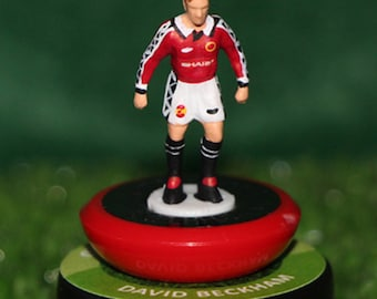 David Beckham (Manchester United)  - Hand-painted Subbuteo figure housed in plastic dome.