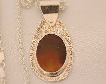 necklace,pendant, sterling silver, Montana agate, cabochan,riveted bail, textured
