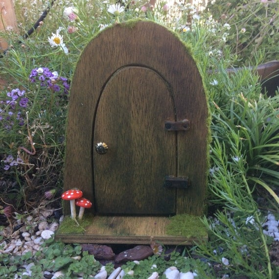Wooden arched fairy door with mushrooms by stephthefairymaker for Wooden fairy doors