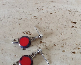 Mini safety pin dangle stud earrings with flat red glass beads.