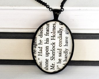 Sherlock recycled book page necklace.