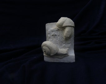 Burgundy snails, reconstituted stone figure.