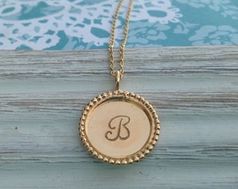 Gold round initial necklace (with dotted edge)