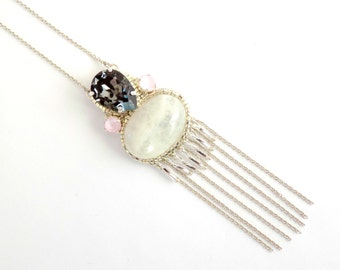 Long silver necklace with crystal stones and moon stone