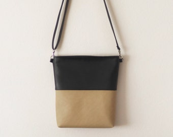 Black and tan light brown vegan leather crossbody bag with zipper