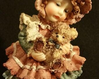 Resin Doll Holding Bear & Sunflowers