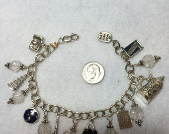Sterling travel theme charm bracelet with carved crystal beads